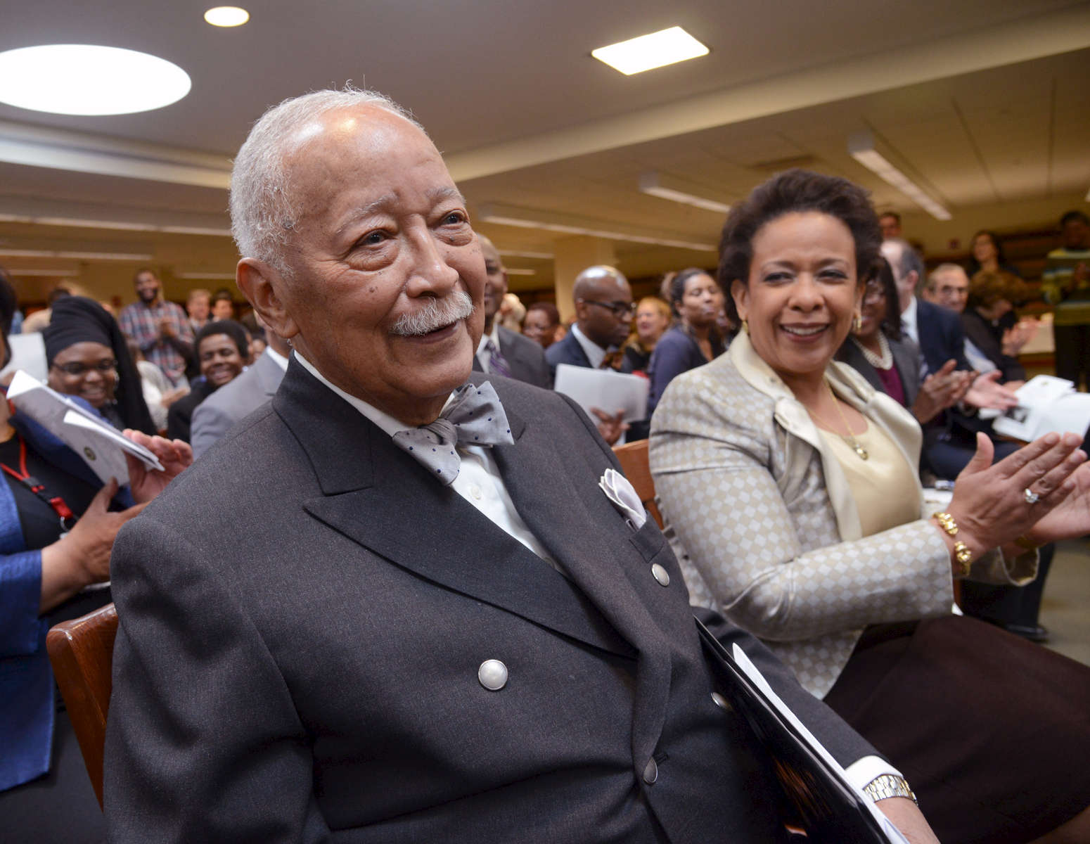 Former New York City Mayor David Dinkins is recognized at a Black History Month celebration at the Eastern District U.S. Attorney's Office; at right is Eastern District U.S. Attorney Loretta Lynch - February, 2015