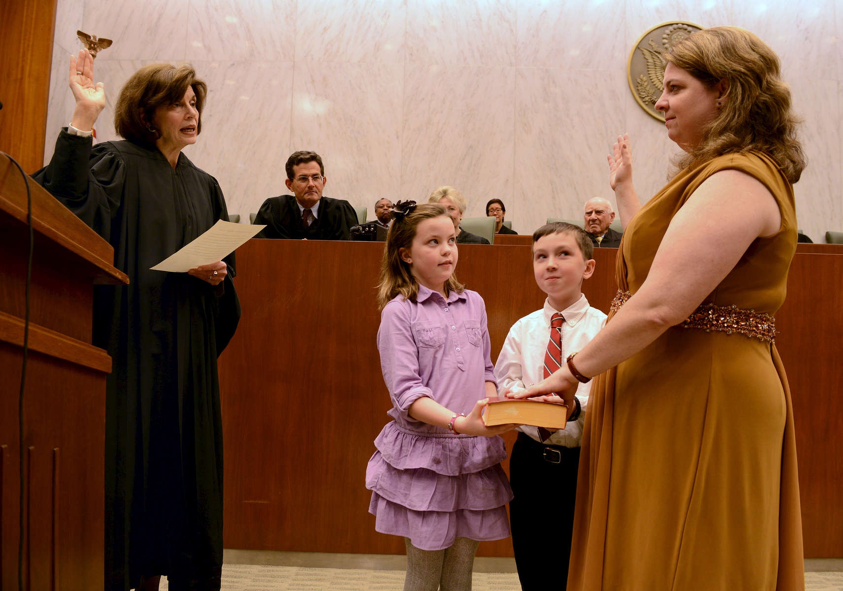 Vera Scanlon is inducted as Magistrate Judge of the Eastern District of   New York.  Her niece Maura Keelty Scanlon and her nephew Brian Lewy White helped with the swearing in - November, 2012