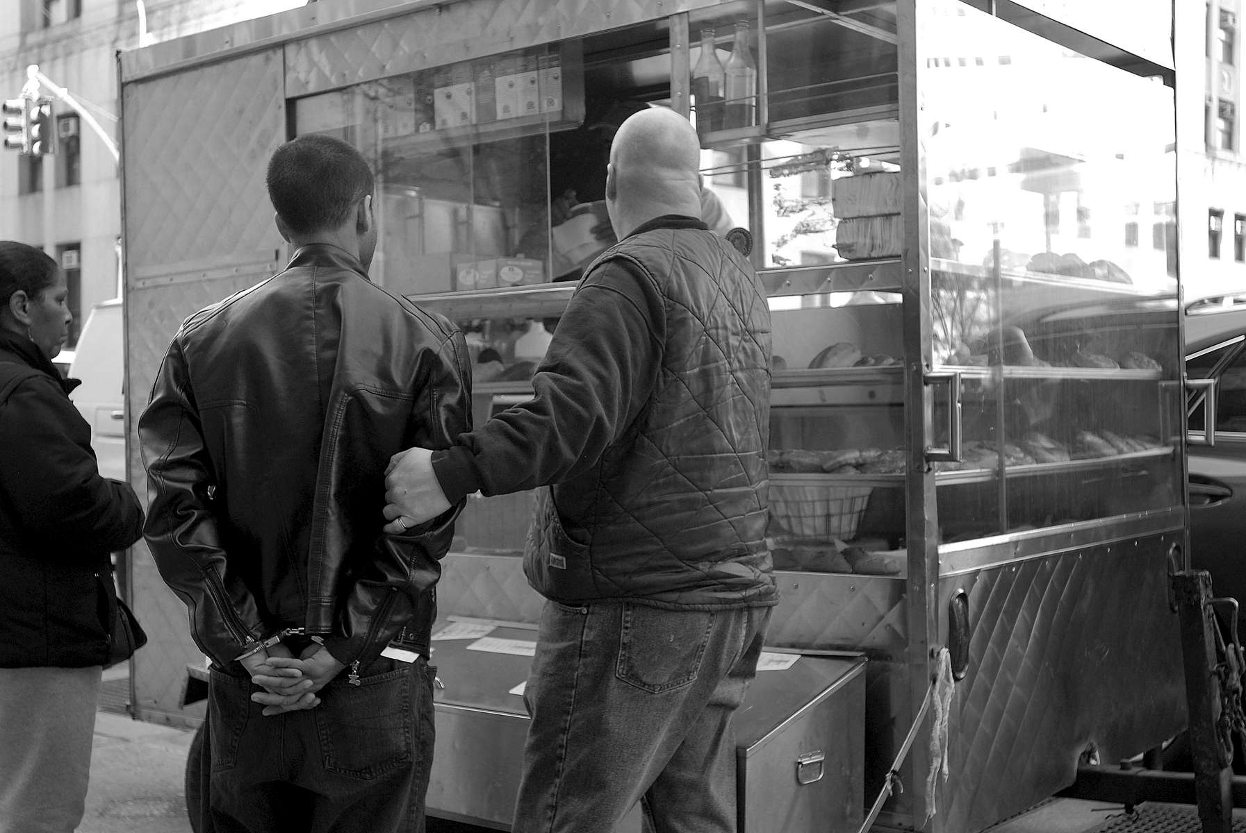 Detective gets coffee before bringing his prisoner into criminal court – 100 Centre Street - March, 2010
