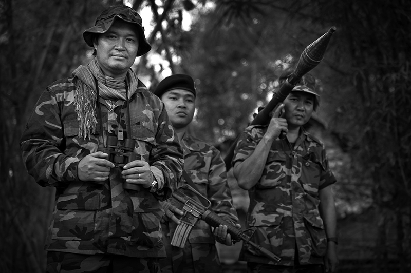 Colonel Ner Dah Mya, commander of the 201 battalion of the KNLA army looks on while planning the partol route to reach the Neapeta village which was recently attacked by the Burmese forces.Colonel Ner Dah is one of the two sons of the legendary KNU leader Saw Bo Mya who died on 23 December 2006 of the heart attack.