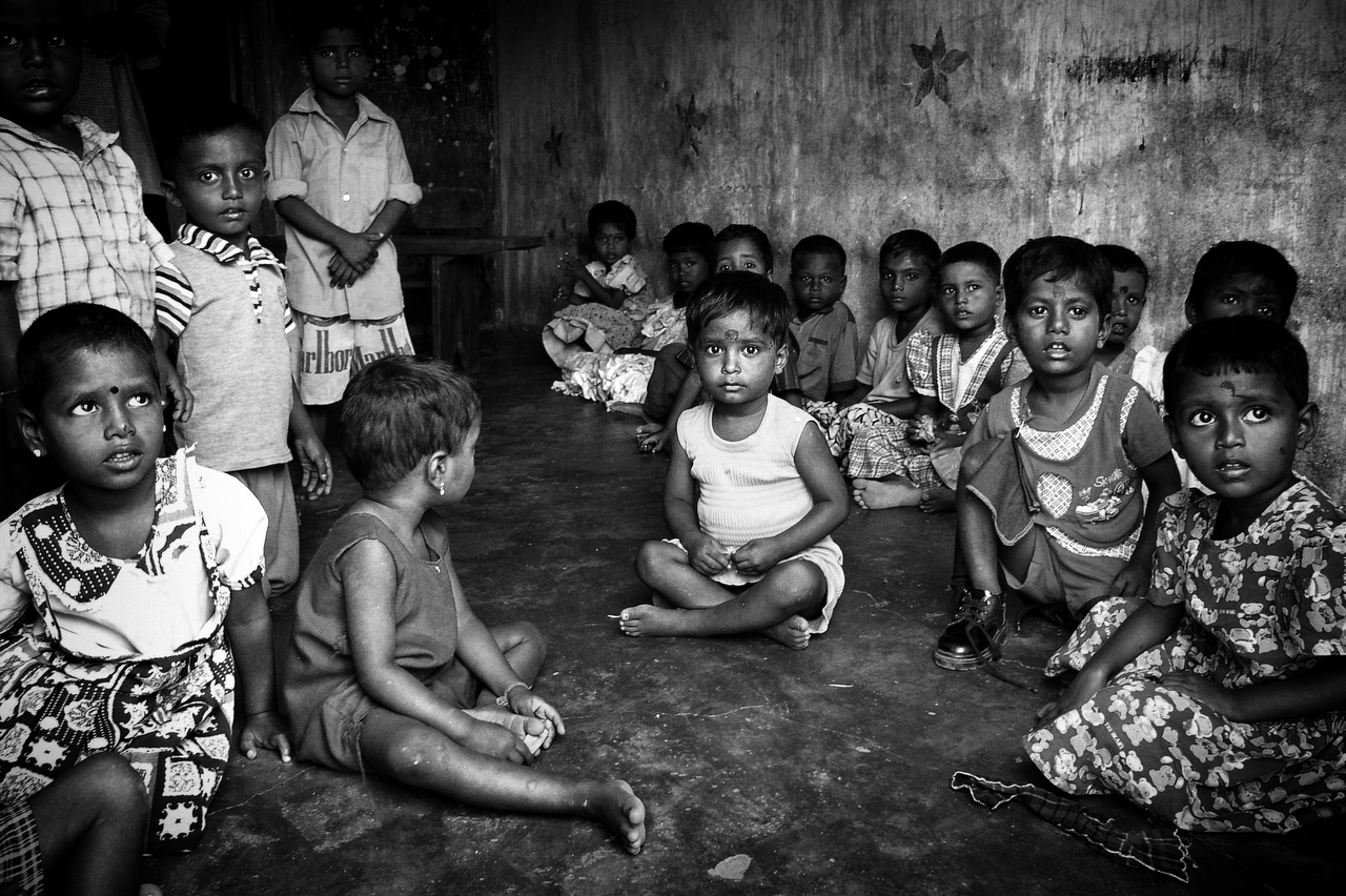 Jaffna, Sri LankaChildren sit on the floor of the orphanage in Jaffna. There are few orphanages which number few hundred children.
