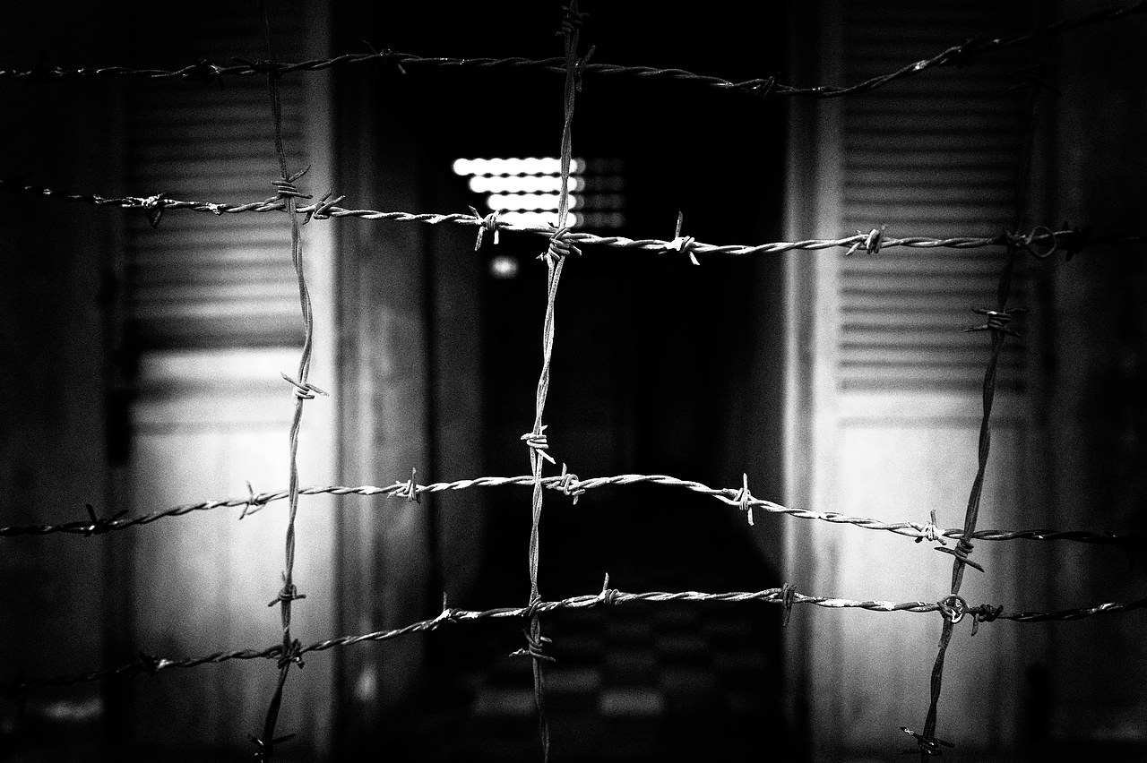 The S21 prison was enclosed by two folds of corrugated iron sheet all covered with dense, electrified barbed wire.