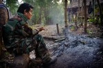 Colonel Ner Dah Mya, commander of the 201 bataglion of the KNLA army looks on while planning the partol route to reach the Neapeta village which was recently attacked by the Burmese forces.Colonel Ner Dah is one of the two sons of the legendary KNU leader Saw Bo Mya who died on 23 December 2006 of the heart attack.