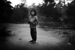 Ethnic Karen girl stand amid almost empty village