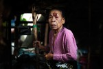 An elderly ethnic Moro woman with a cancer in her forehead is seen in front of her makeshift shelter in Datu Piang, IDP camp, Maguindanao