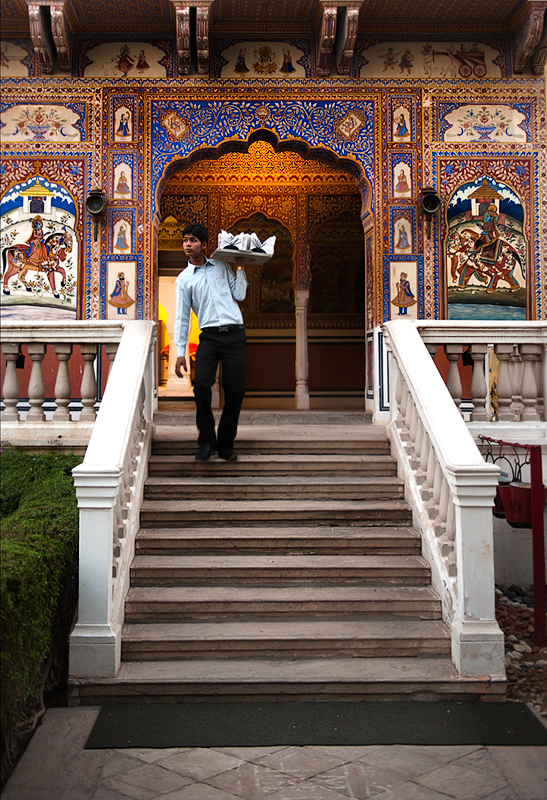 Waiter carry food at the heritage hotel castle Mandawa, Mandawa Rajastan.