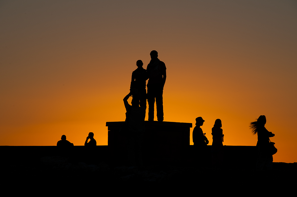 Tourist wach sunset over Jaisalemer city.