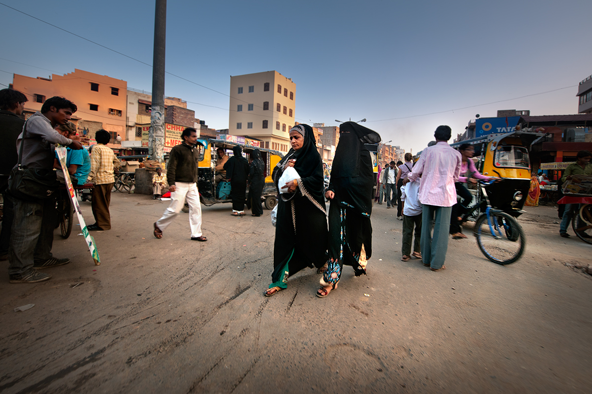 Muslim women walk downtown Jaisalmer.Jaisalmer although majority of population are Hindu there are some 56.6 percent Muslims.