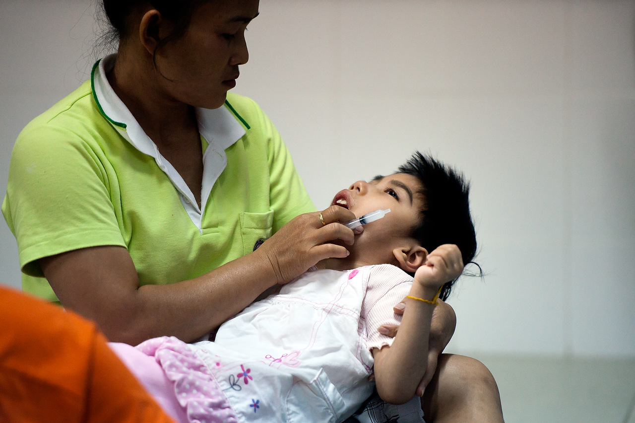 Nang is 7 years old receives her antiretroviral medication.She is HIV positive and severely disabled, her mother was unable to look after her and she was brought to Camillian Home from Chiang Rai (North Thailand) She has no identification papers, making it difficult to receive help from government hospitals.