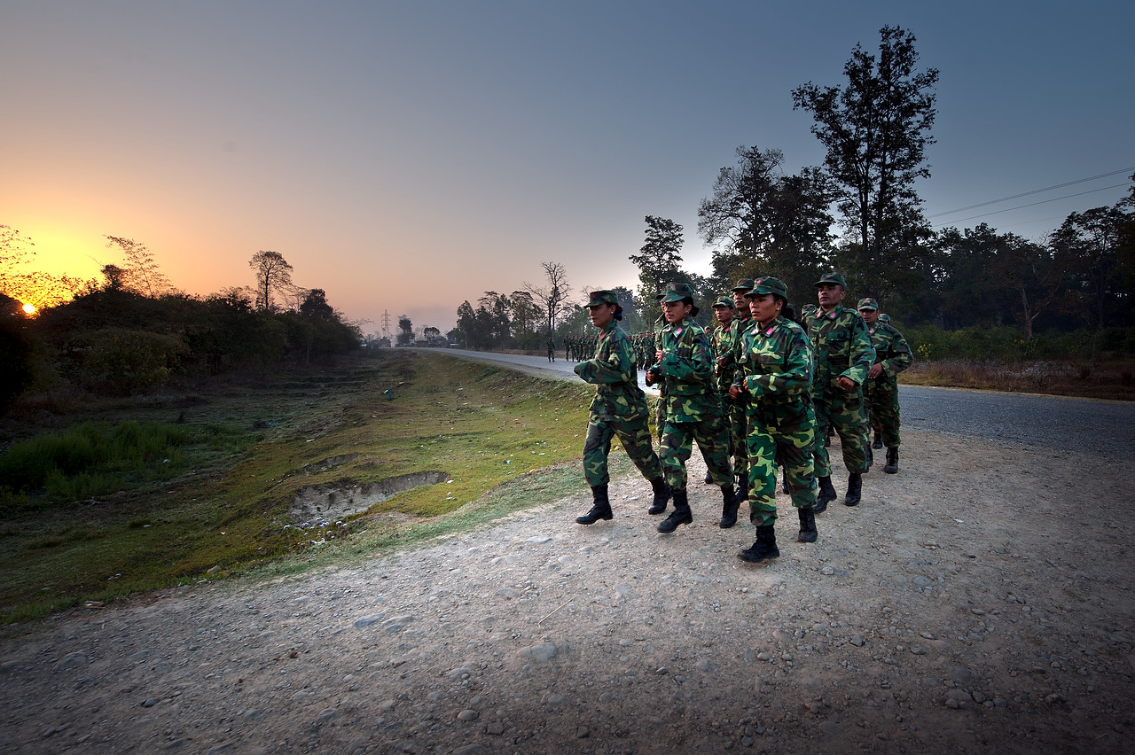 PLA fighters run five kilometers along the main highway in Kilali every morning.