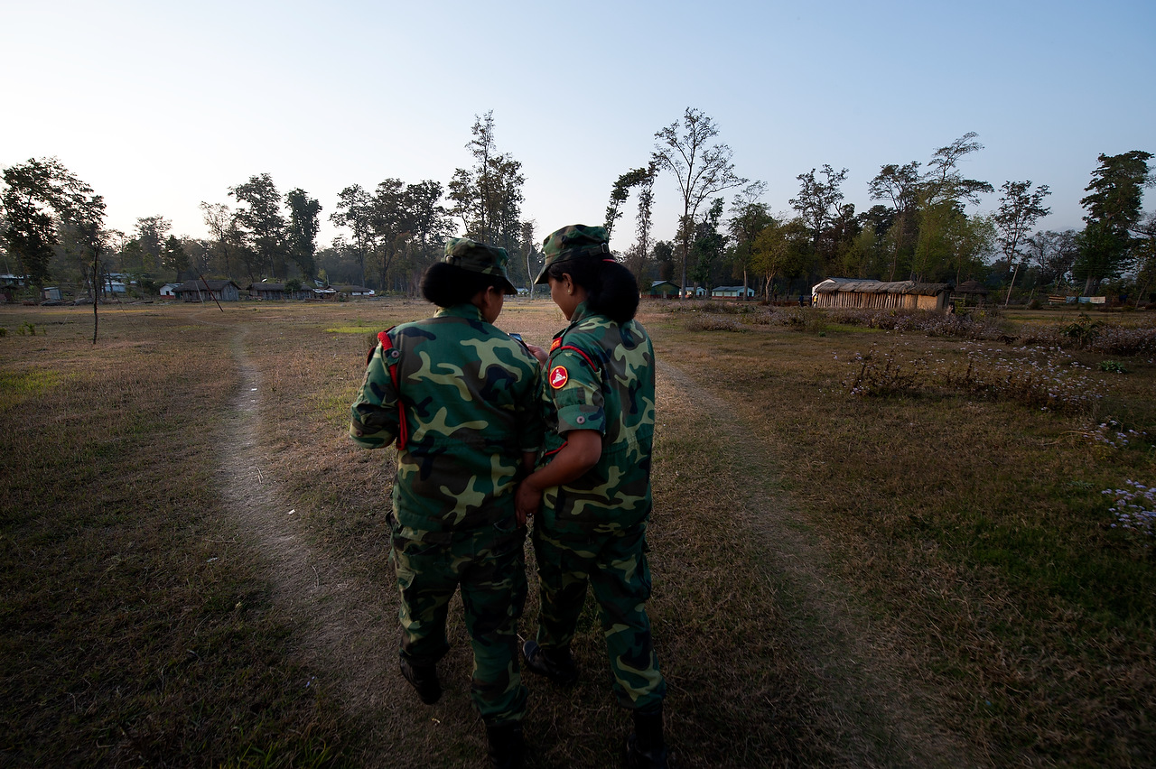 PLA female fighters check their mobile phone while returning from training in Lishengam memorial brigade conatonment in Kilali in far western region of Nepal. Some 6,000 female fighters waiting to be intergrated in the Nepal Army.