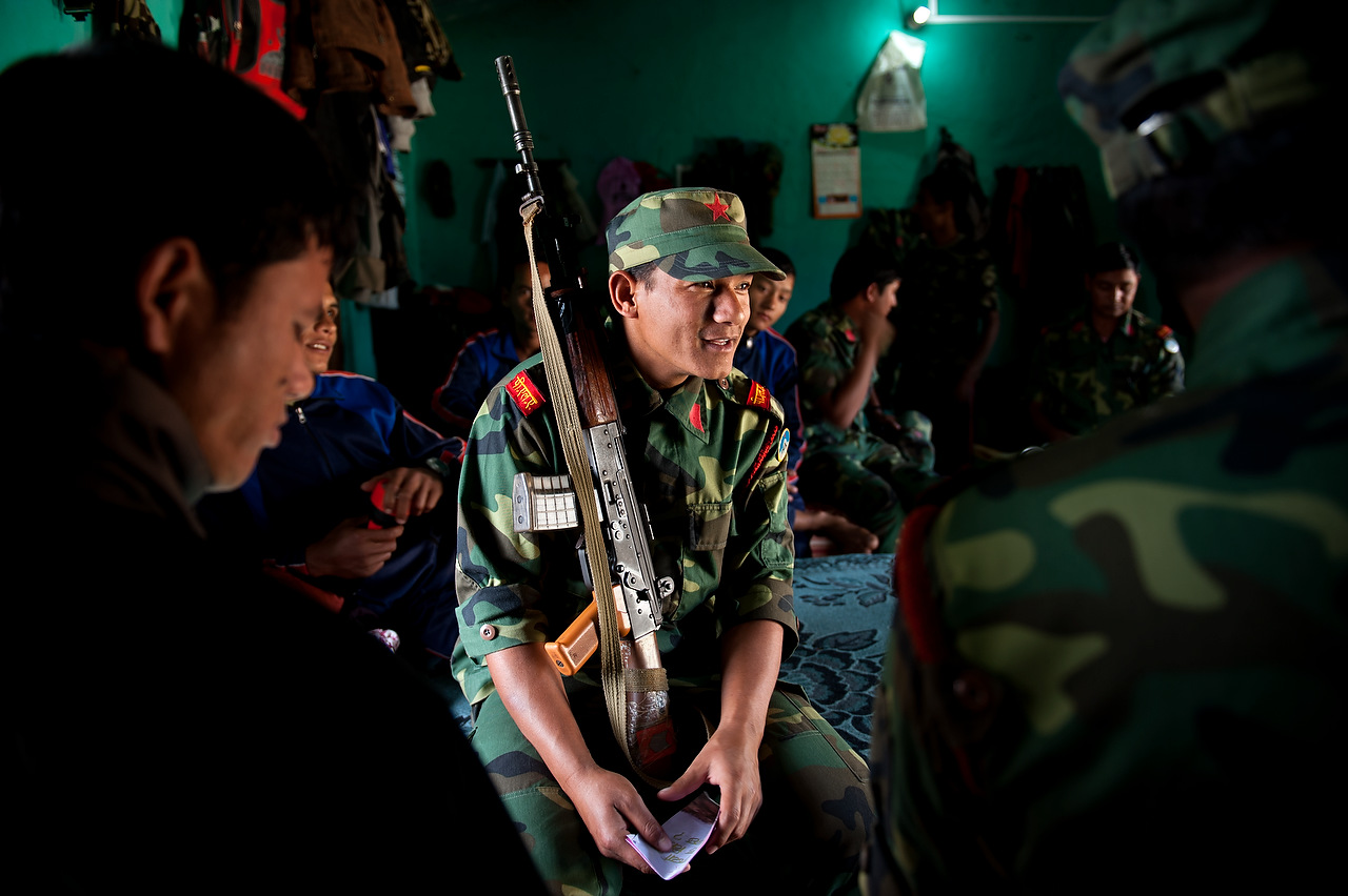 A PLA fighter talks to his commrades in the dormitory of the Lishengam memorial brigade, PLA cantonment in Kilali, far western region of Nepal.