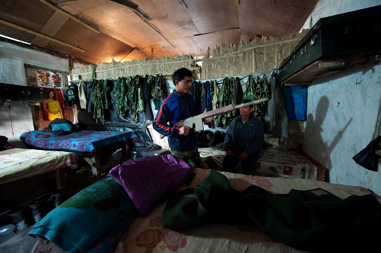 A PLA fighter puts back a dummy rifle in the dormitory after the training in Lishengam Memorial Brigade PLA cantonment in Kilali, far western region of Nepal.
