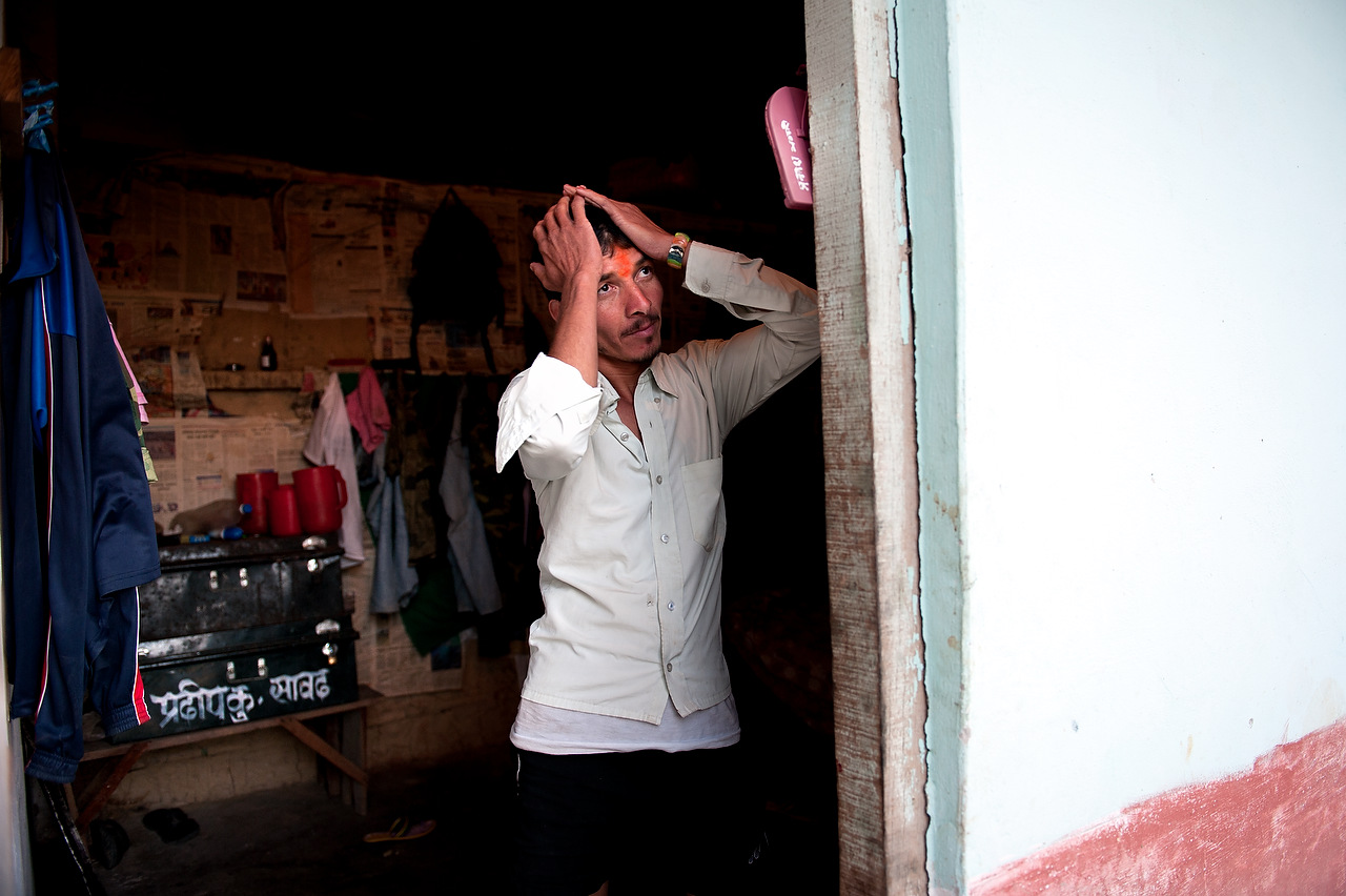 A PLA member grooms his hair inside the dormitory in Lishengam memorial brigade of PLA cantonment in Kilali, far western region, Nepal.