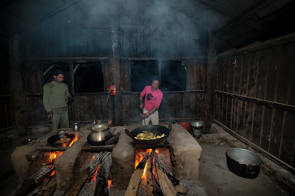 As the evening falls mahouts cook dinner in their compound at Chitwan Hattisar Soura elephant stable.