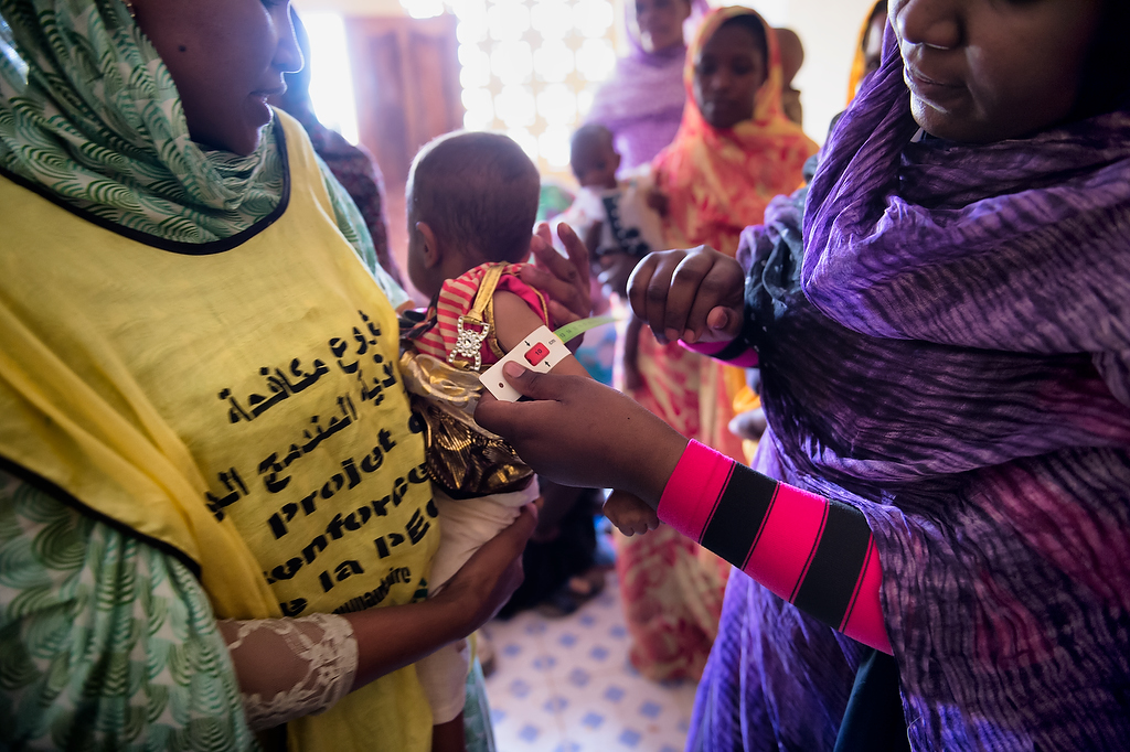 A child's  mid-upper arm circumference (MUAC) is measured during the screening campaign on malnutrition in CRENAS centre, Tidjikja, Mauritania. The measurement of MUAC at this child reads severe malnutrition. She was immediately referred to further treatment.During the malnutrition screening children and their mothers undergo anthropometric measurements containing weight for height, upper arm circumference and general check up. Children who\'s anthropometric measurements fall under general recommendation are referred further for treatment as required. In the centre appetite test is performed for children who are screened as malnourished.UNICEF CRENAS centre is suited within maternity ward building in Tidjikja and it is managed by NGO AMAMI.