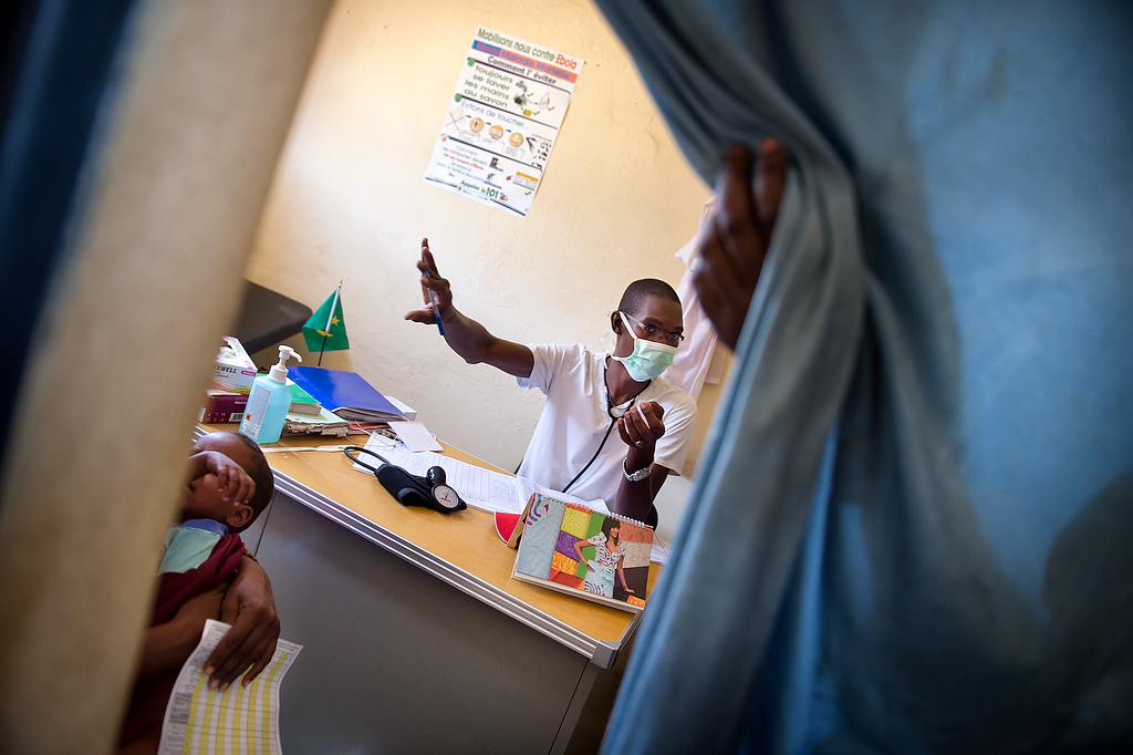 A doctor prepares to check up the child at the CRENAM clinic. During the screening for malnutrition children are referred to the doctor for thorough medical examination in order to identify possible further complications that Severe Acute Malnutrition may have been caused by.   In the Mbera refugee camp, the Nutrition survey carried out in November 2014 showed a significant decrease of both global acute malnutrition (from 11.8 to 9.9%) and severe acute malnutrition (1.4% to 0.8) rates. As of today, UNICEF has been supporting the government nutrition center in the treatment of 444 severe acute malnutrition (SAM) cases and contributed to the treatment of 790 other SAM cases.