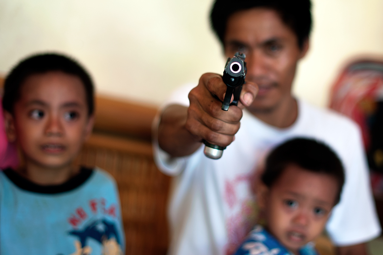 Two households, both alike in dignity... From ancient grudge break to new mutiny. ShakespeareDodz Surak points his gun as a sign of his determination to defend his family. Several years ago his family entered blood feud as his cousin was killed while trying to negotiate reconciliation between two feuded families in area of Cotabato city in Mindanao. Subsequently Dodz and his family killed several members of the rival family. In fear of retaliation Dodz always carries not only a hand gun but also M16 rifle and ammunition. He has never been arrested for killing of the rival family members.