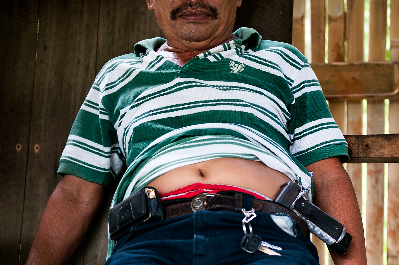 Napoleon Inog (48) former mayor of Balabagan carry a hand-gun at all times as his family is in the blood feud. Five years ago Napoleon was a member of the reconciliation committee of Cotabato city and acted as a negotiator between several feuded families. As his brother was killed, he and his family is in the blood feud.
