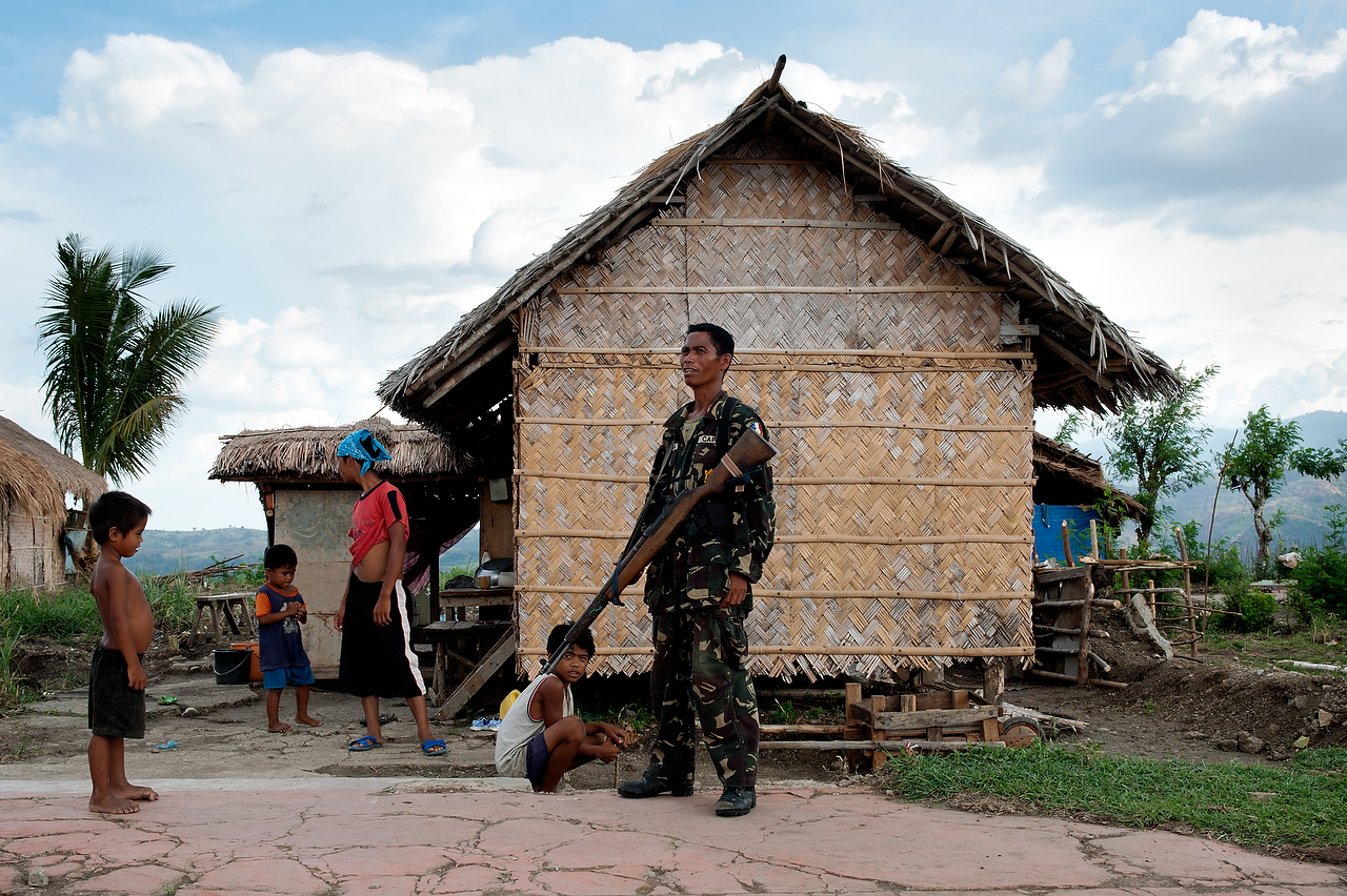 Member of the CAFGU paramilitary in front of his house in Datu Hoffer, Maguindanao.