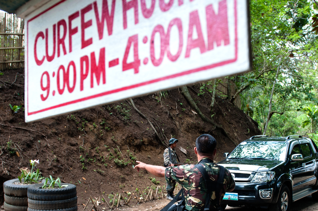 Check point at the entrance in the MILF controlled area. Curfew is imposed from 9 pm - 4 am. For decades, the Moro Islamic Liberation Front (MILF) and its military wing Bangsamoro Islamic Armed Forces (BIAF) rebels have been fighting the Philippine government to gain an independent state of Bangsamoro, but the struggle for self-determination dates from 16th century when the Spaniards sent military expeditions to subjugate the Muslims.The fight for independent state of Bangsamoro entered its 60th year.