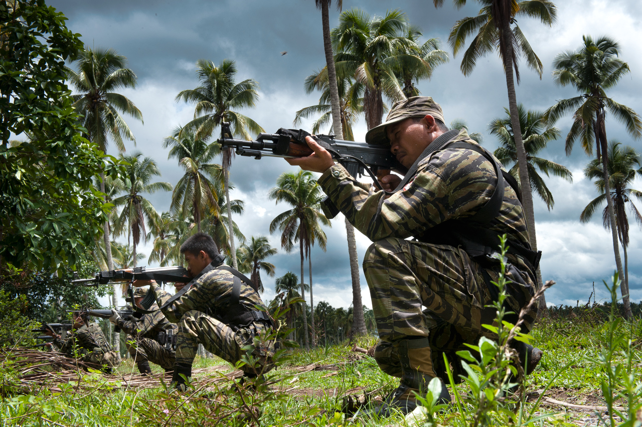 Bangsamoro Islamic Armed Forces (BIAF) rebles at the shooting range in their training camp.BIAF is the armed force of the Moro Islamic Liberation Front (MILF) and they fight for independent Islamic state.