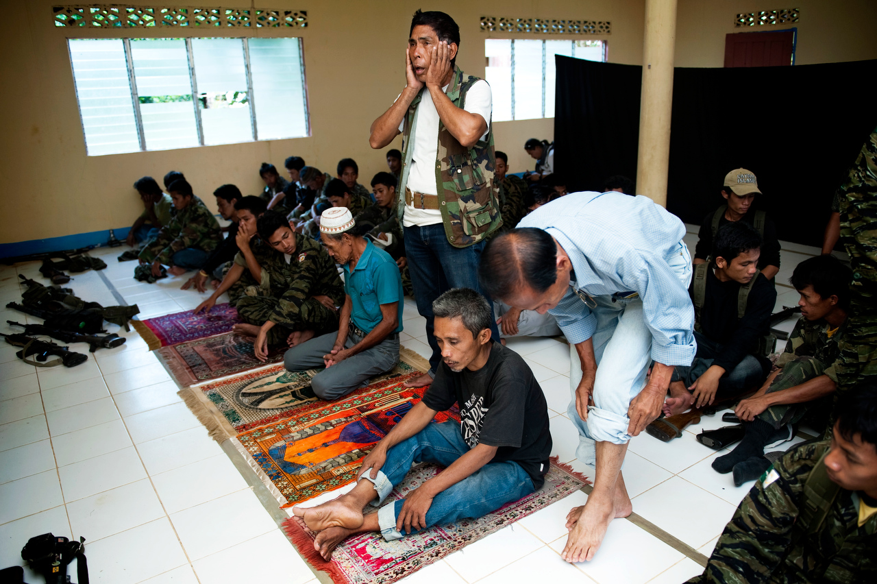 MILF rebel commander Ismael Sawa, of the 5th brigade 18th base command in Buluan camp, Maguindanao calls for prayer.