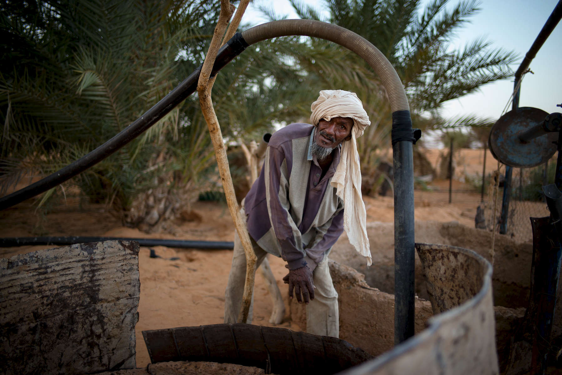 Jeidu fetches water from the well in Lhueeb, nomad camp in outskirts of Chinguetti.