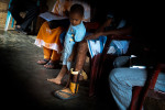 A boy looks his father's prosthetic foot. Mahmood is the land mine survivor and the Internally Displaced person from Sampur. He lost his foot while fetching firewood. It is estimated that more than 700,000 anti personel mines were planted by government forces and the LTTE in Sri Lanka.