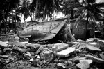 Valvettithurai, Jaffna.A boat lay amid destroyed houses bu the Tsunami.