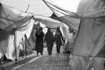 Syrian refugees walk inside a refugee camp in Reyhanli, Turkey. March 2012.