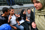 In spite of the Islamist-influenced school system, Algerian youths appear to be more socially liberal than their counterparts in places like Egypt or Jordan. Outside Okba Ben Nafaa high school in Algiers, a young veiled woman sat leg to leg with young boys, which is unthinkable in some Muslim countries. May 2008.