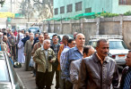Men line up outside of a polling station in Cairo, Egypt. November 2011.