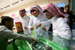 Young Saudi men shopped for mobile phones at a store in Riyadh. With so few opportunities to meet members of the opposite sex, mobile phones and Bluetooth technology allow them the ability to safely flirt at malls, restaurants and even traffic lights. March 2008.