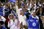 Young men cheered at a soccer match between Al Hilal Riyadh and Al Nasr Riyadh. Women are not allowed to attend matches. December 2008.