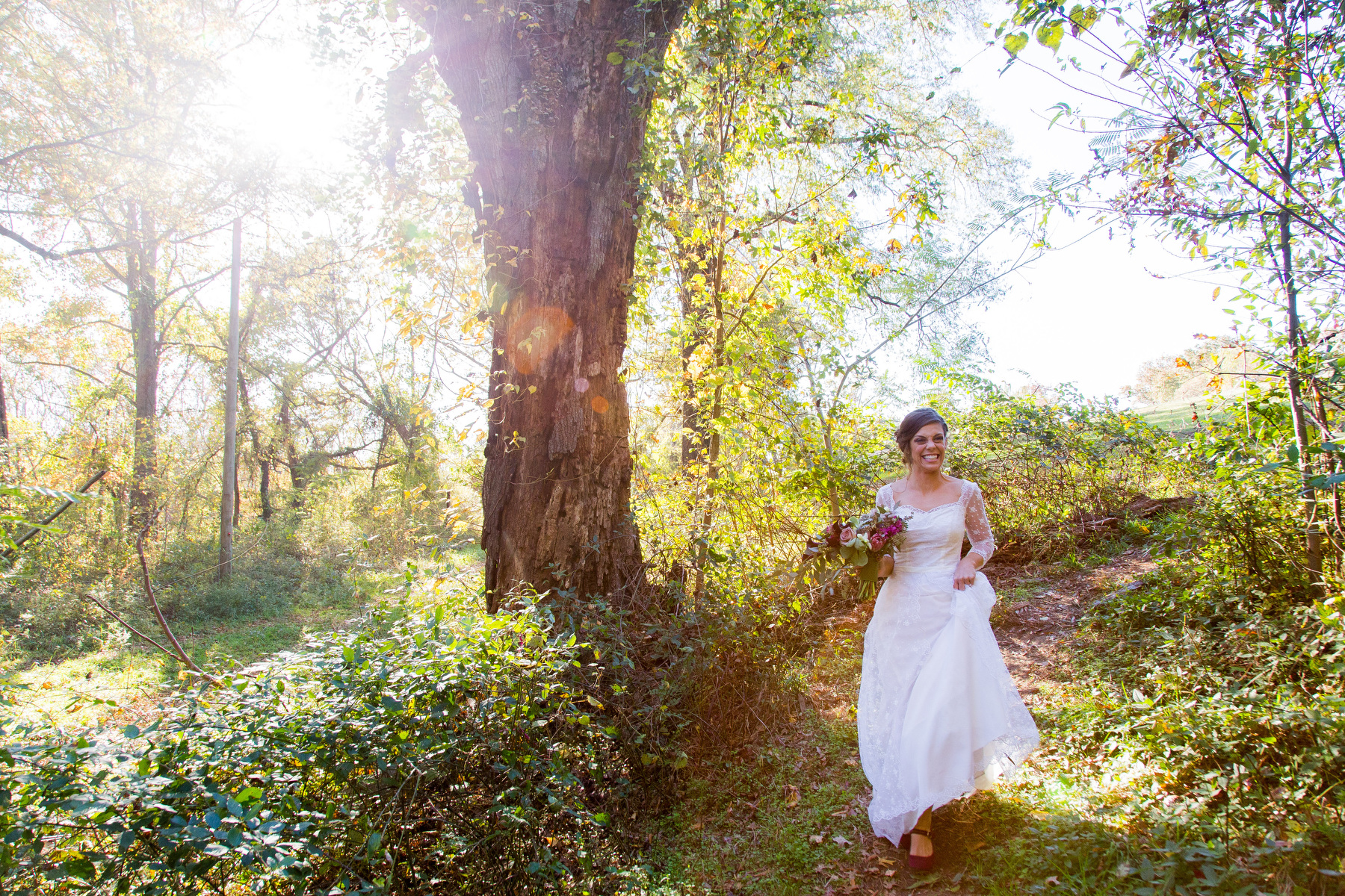 A bride walks down a Chimborazo Park path during a portrait session in Richmond, Va.