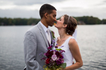 A bride and groom kiss during their wedding at Lake of The Woods Club in Locust Grove VA