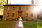 A bride poses just prior to her wedding in front of the Wilton House Museum in Richmond, Va