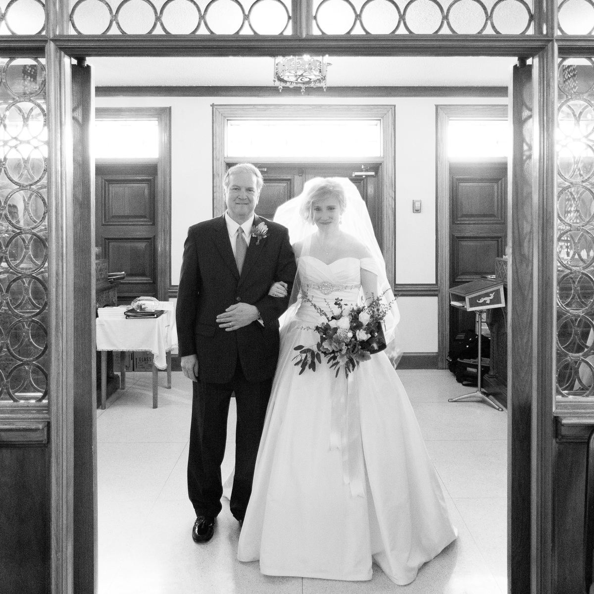 A bride and her father at the start of her wedding ceremony at Sts Constantine & Helen Greek Orthodox Cathedral in Richmond, Va