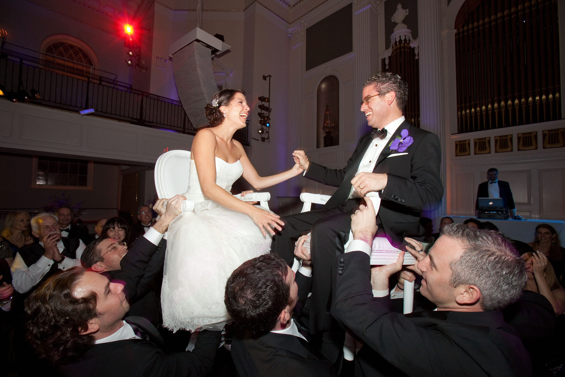 A Bride and groom dance the hora at 583 Park Ave in New York, NY