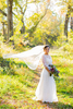 A bride poses for portraits in Chimborazo Park just before her wedding in Richmond, VA