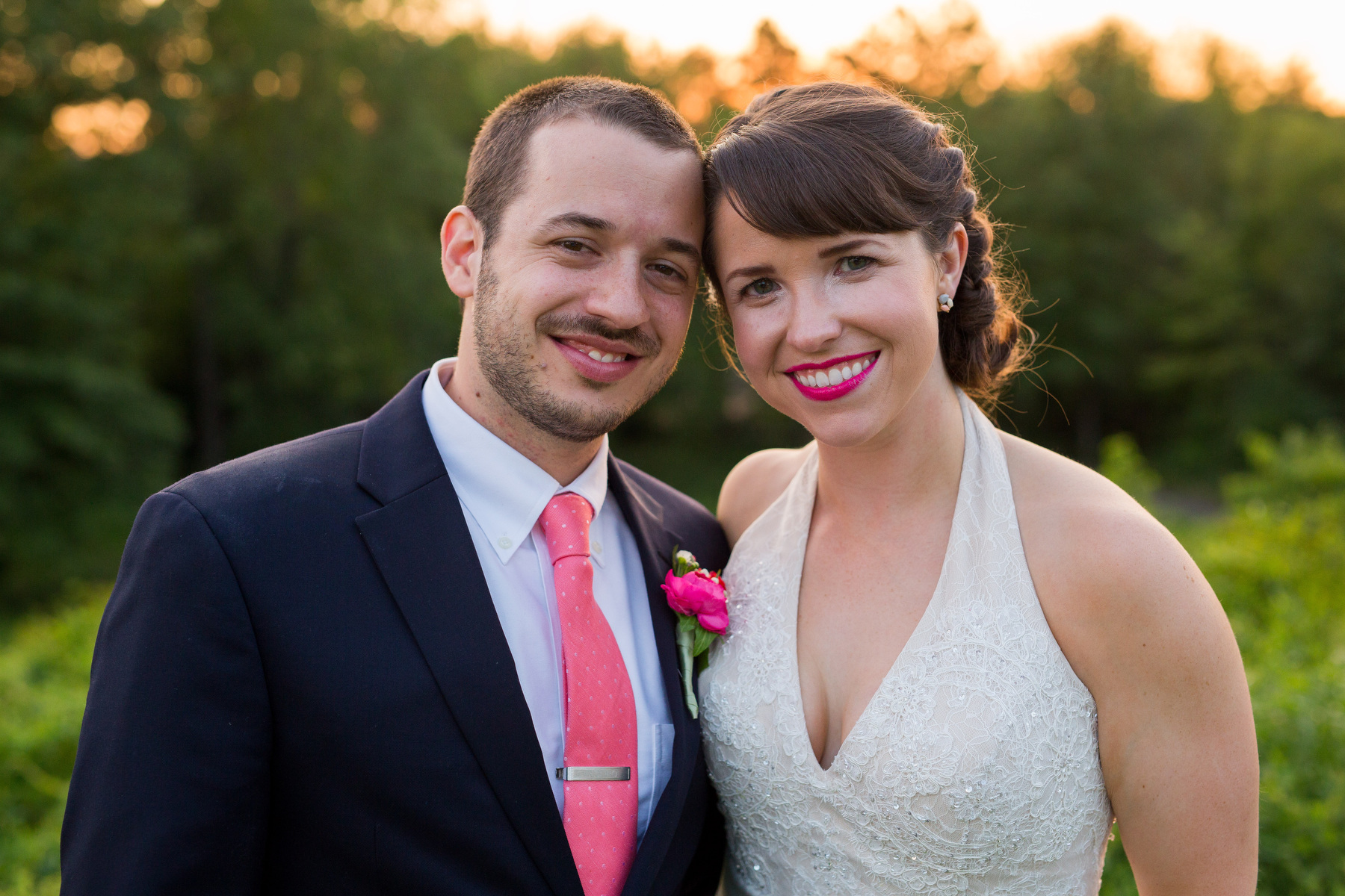 A bride and groom pose for portraits at The Piedmont Club during their wedding.