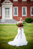 A bride poses in front of Westover Plantation