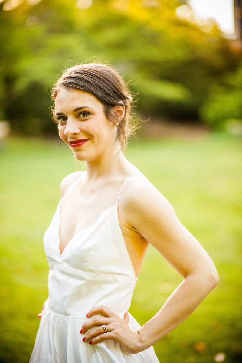 A bride poses for a portrait during her wedding at Woolen Mills Chapel in Charlottesville, VA