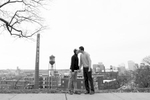 Two grooms kiss during their engagement portrait session in Libbie Hill Park in Richmond, VA