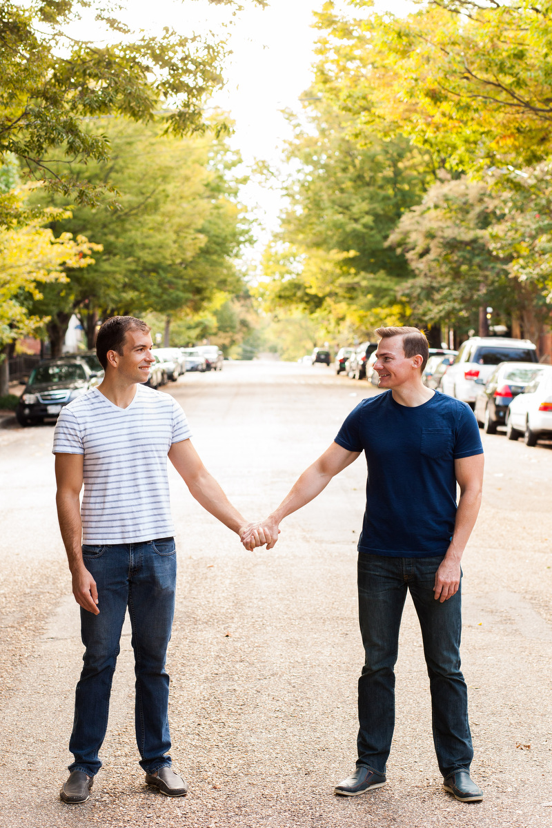 Two groom pose for engagement portraits in Church Hill in Richmond, VA