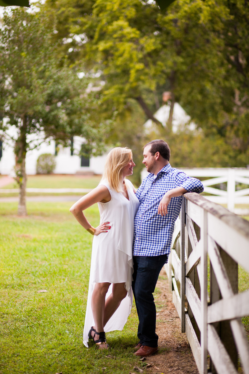 A bride and groom to be pose for engagement portraits in Historic Williamsburg, Va
