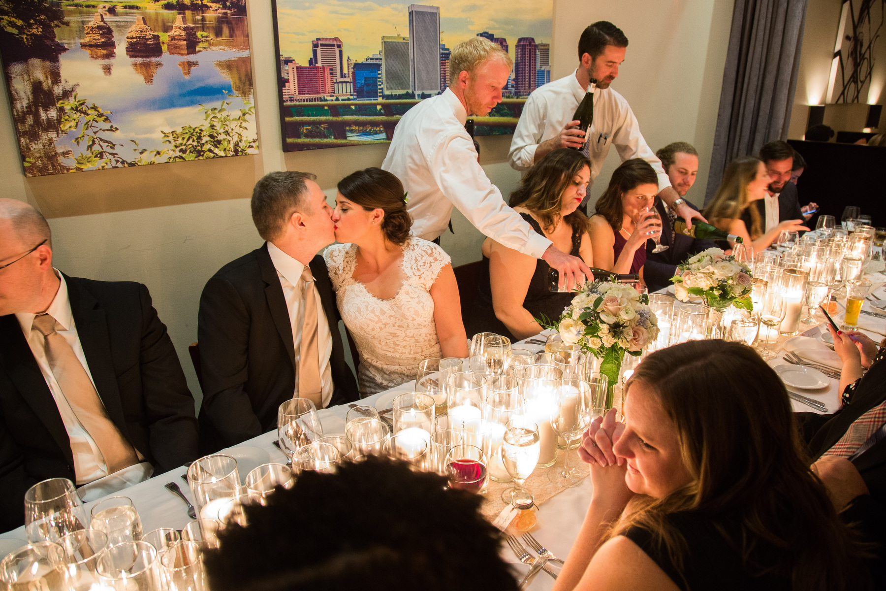 A bride and groom steal a kiss during their wedding reception at Julep's in Richmond, VA