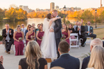 A bride and groom kiss at the end of their wedding ceremony at The Boathouse at Rocketts Landing in Richmond, Va.
