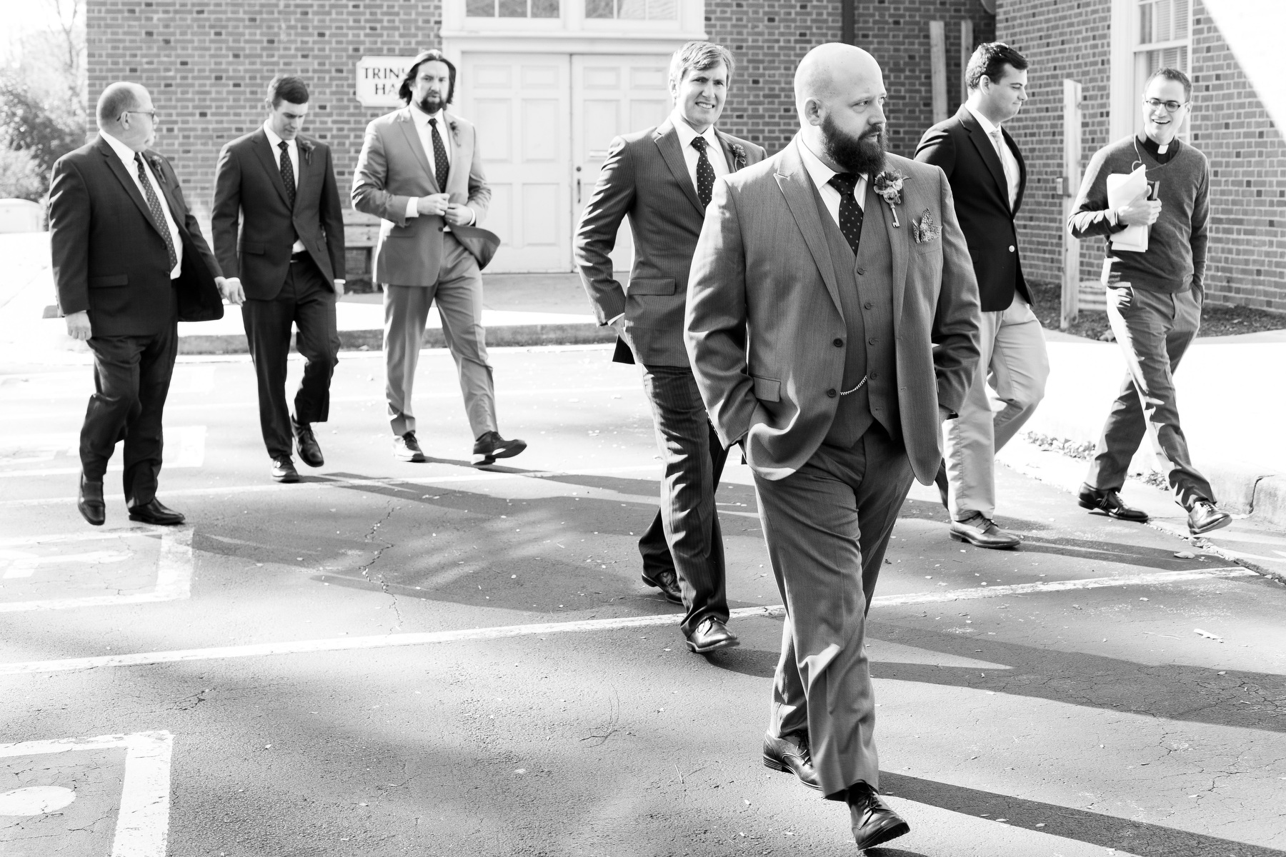 A wedding party strolls to the wedding ceremony at Trinity Methodist just before the Receptio at Berkeley Hotel in Richmond, VA